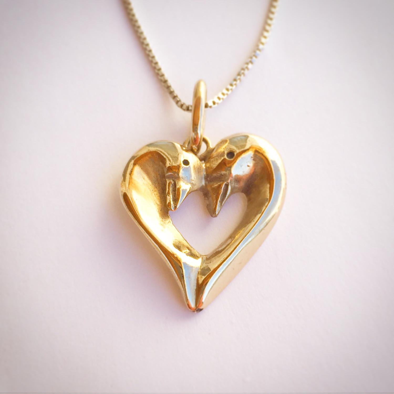 Gold swan heart pendant