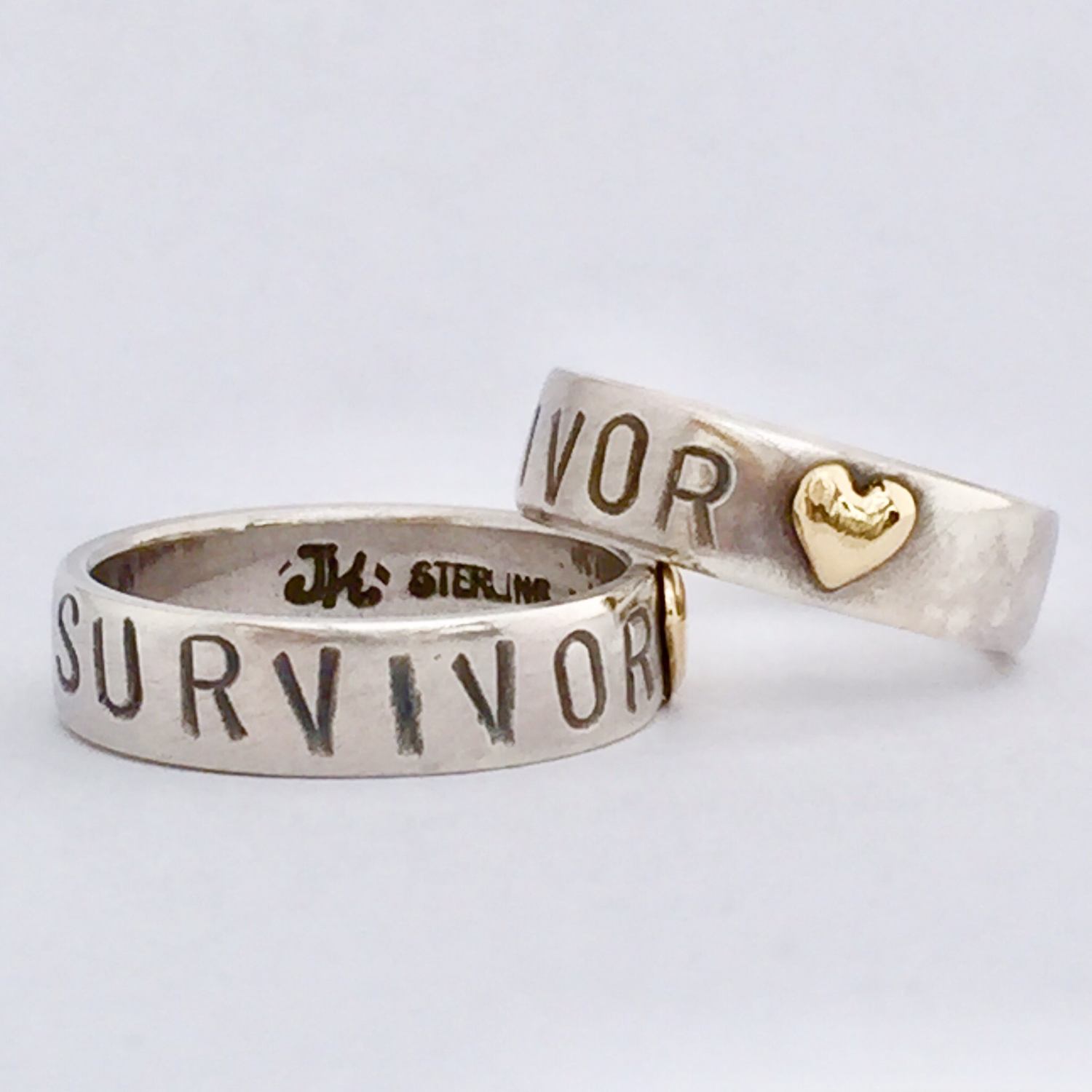 Survivor ring in Sterling Silver with 18k gold heart