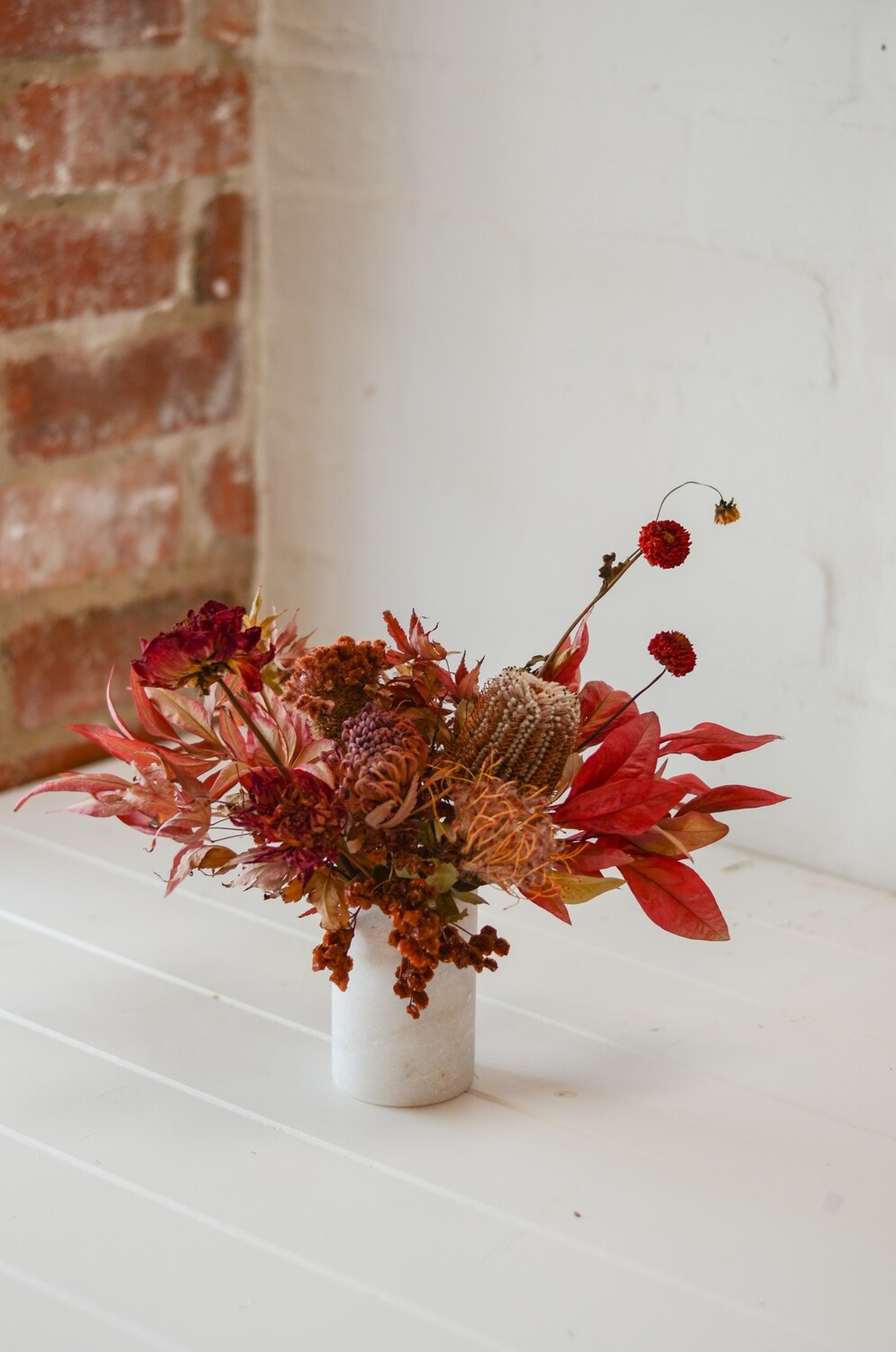 Autumn Leaves in a Marble Vase