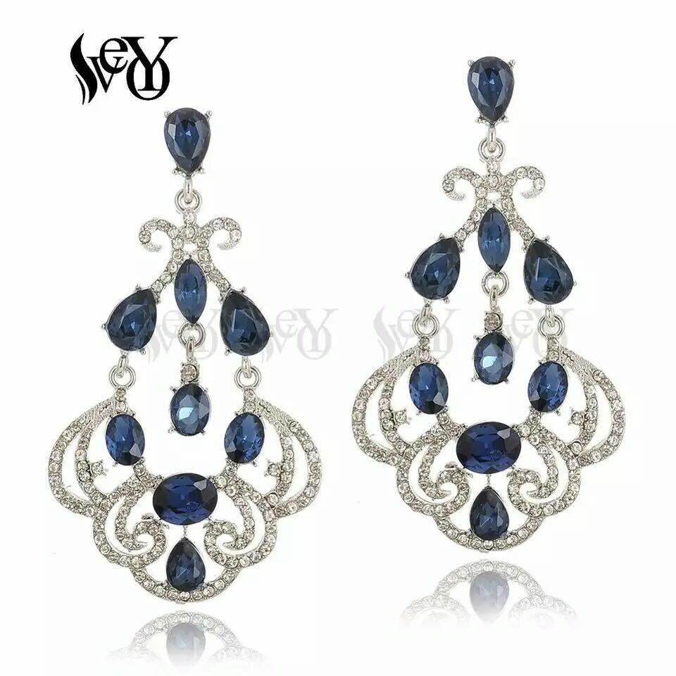 silver and blue earring