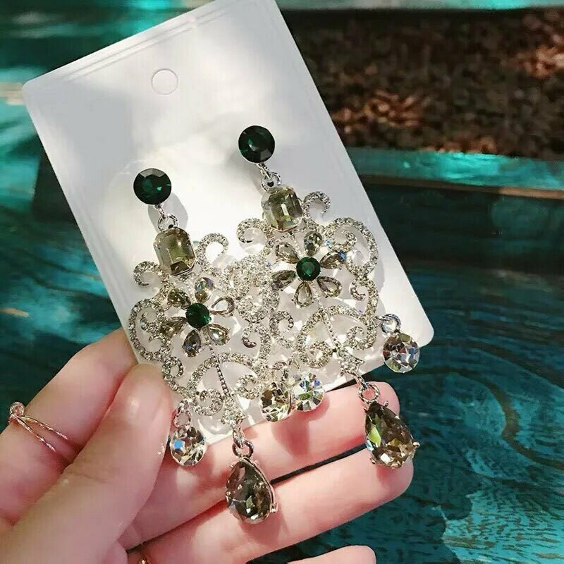 green and silver earring