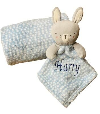 Blue spotty blanket and comforter set