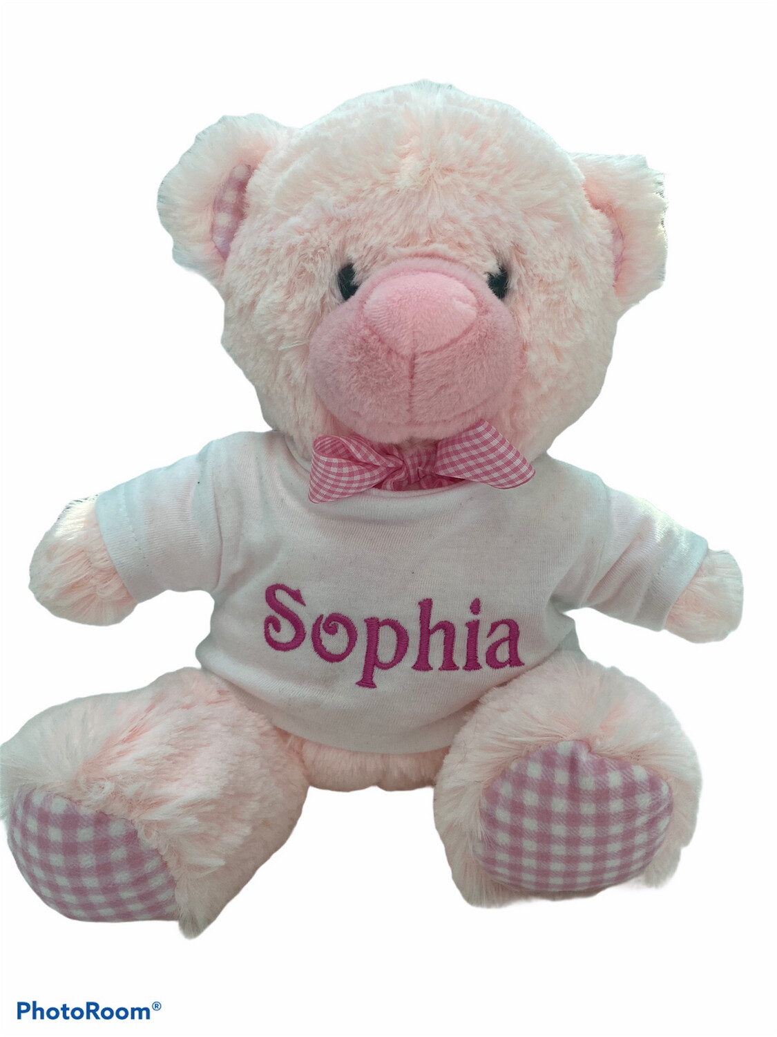 Small pink  teddy bear with spot ribbon