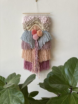 Small  woven wall hanging 25 cm wide.