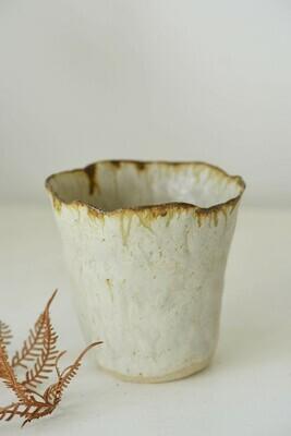 handbuilt vase with ash glaze and iron drips