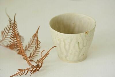 tea cup with runny ash glaze