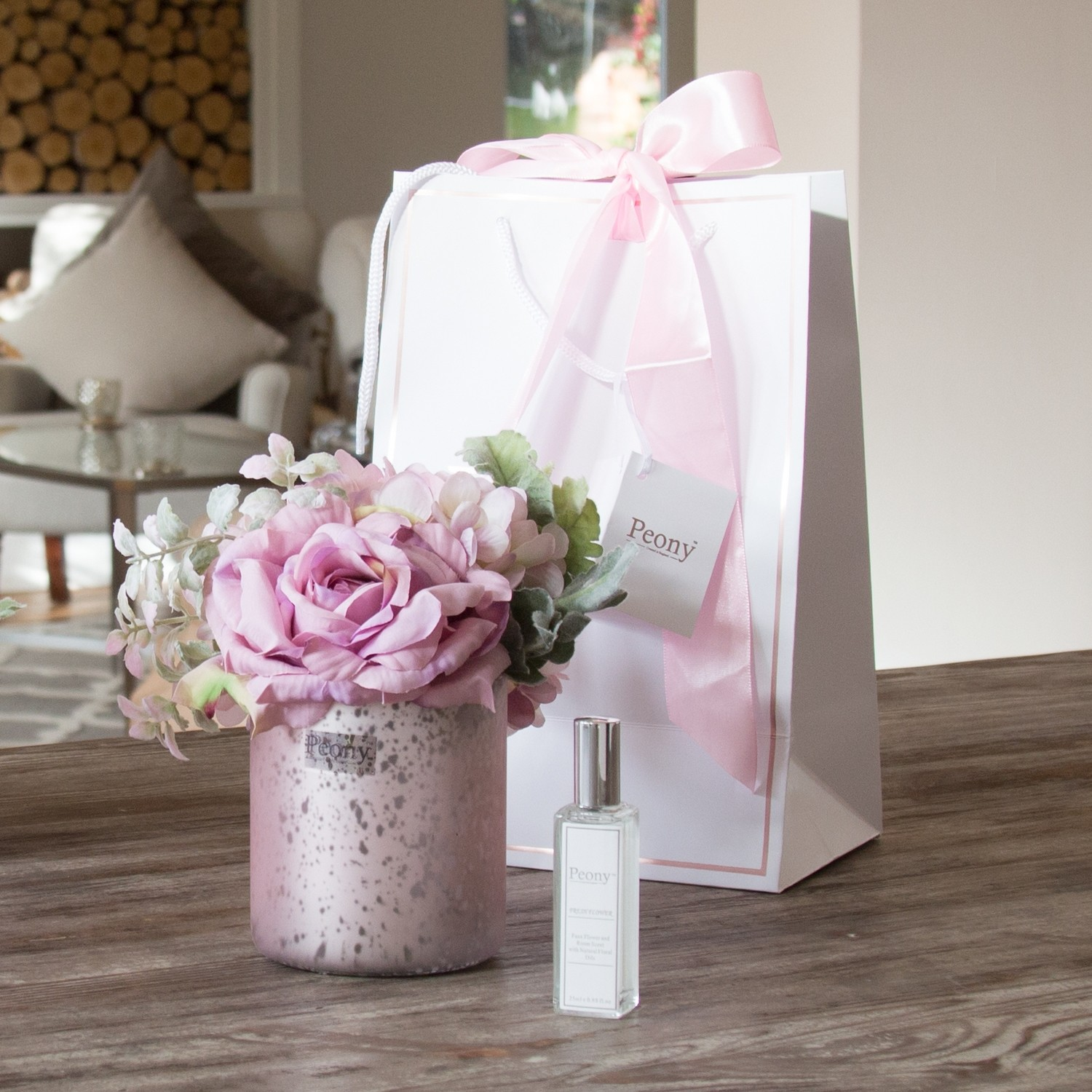 Rose, Hydrangea and Foliage in a pink Mercury vase