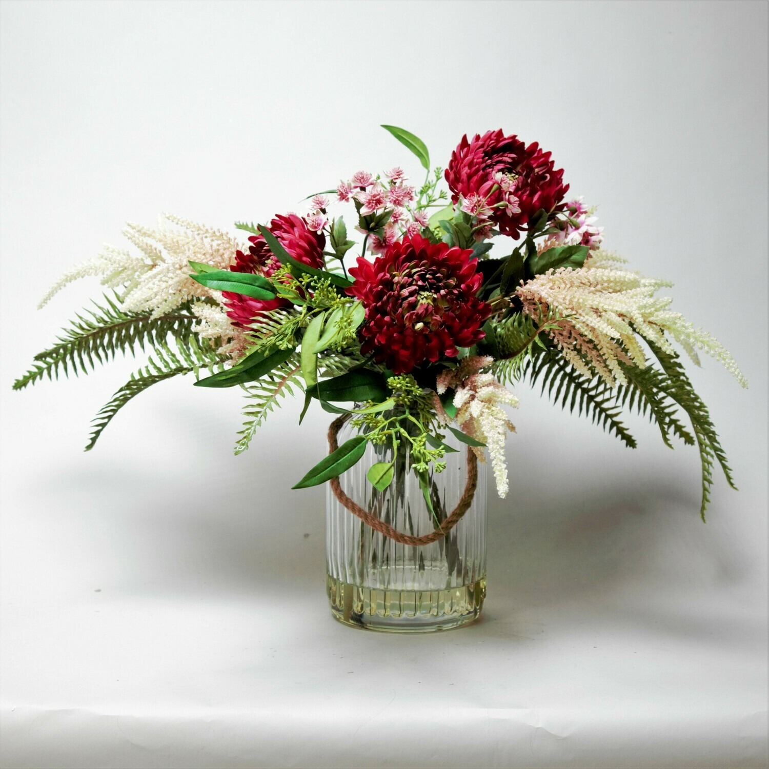 Chrysanthemums, Astrantia and Astilbe with Foliage in a Rope Lantern