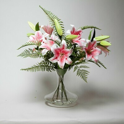 Casablanca Lily and ferns in a decanter vase