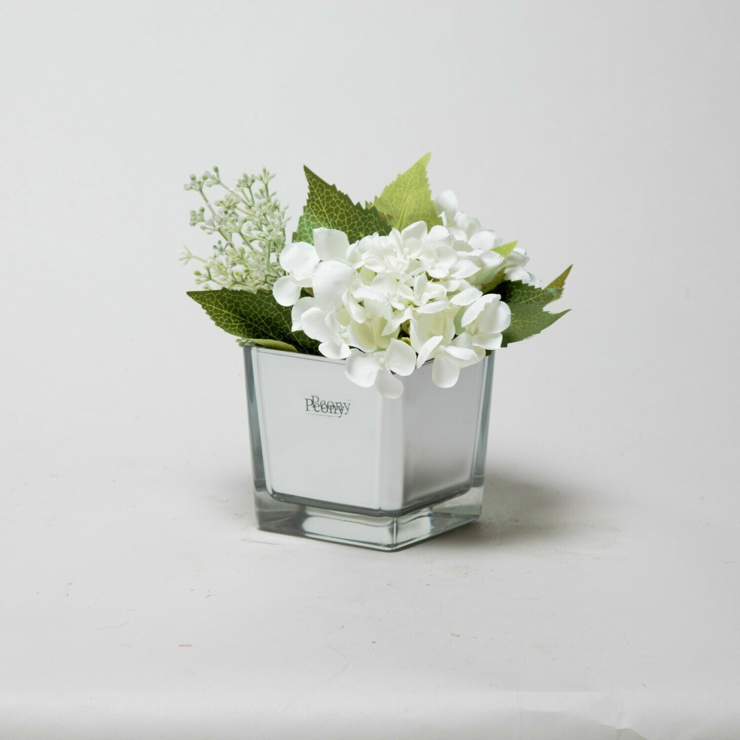 White Hydrangea and Eucalyptus seed in a mirror cube