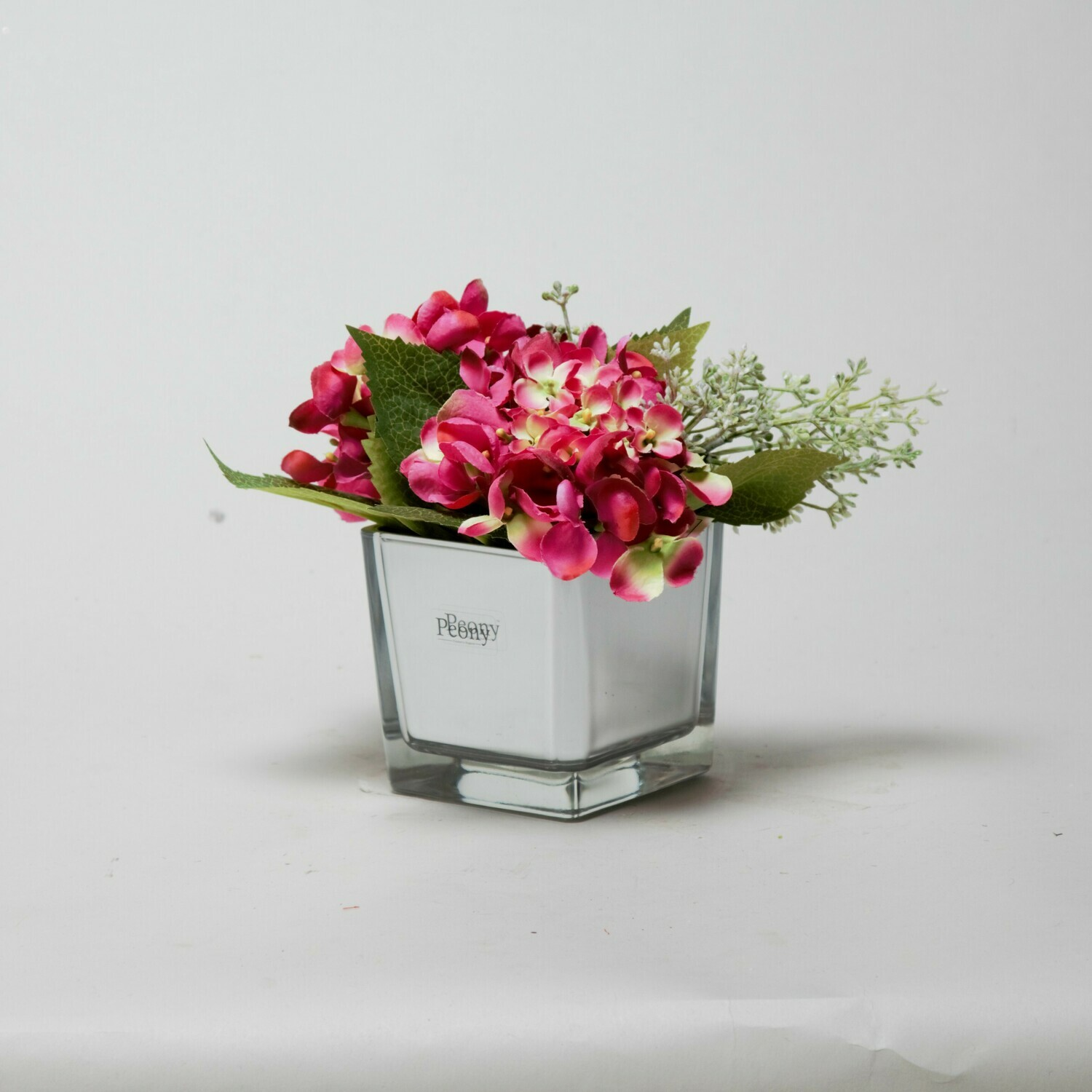 Fuchsia Hydrangea and Eucalyptus seed in a mirror cube