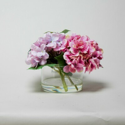Fuchsia and Lilac Hydrangea set in cylinder vase