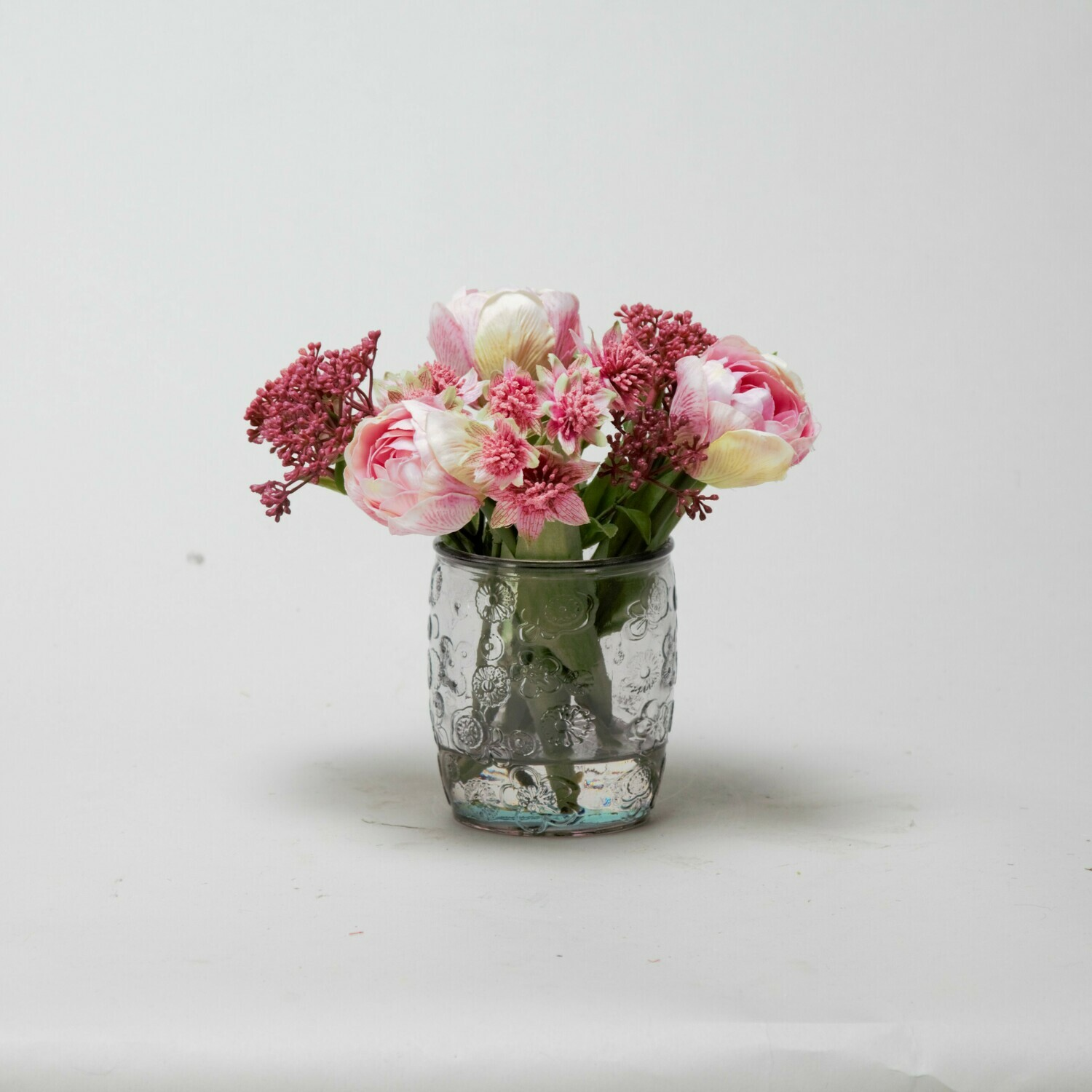 Pink Tulips and Astrantia in textured pink beaker vase