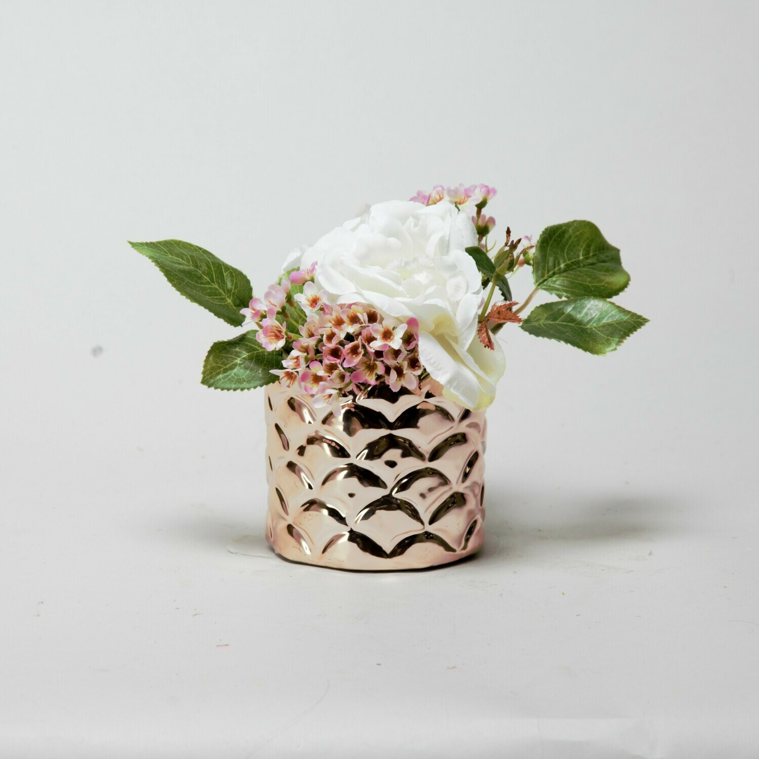 Cream Rose and Wax flower in a scalloped copper pot