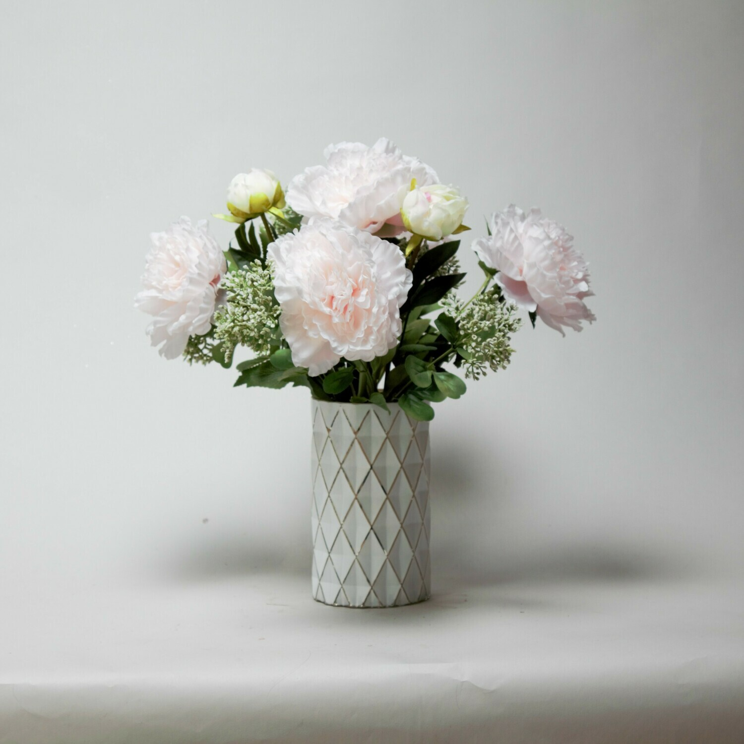 Peonies and Achillea in a diamond textured vase