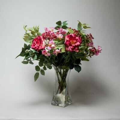 Alstroemeria, Roses and Wax flower in a twisted vase