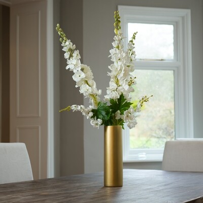 Delphiniums in a Gold Ceramic Cylinder