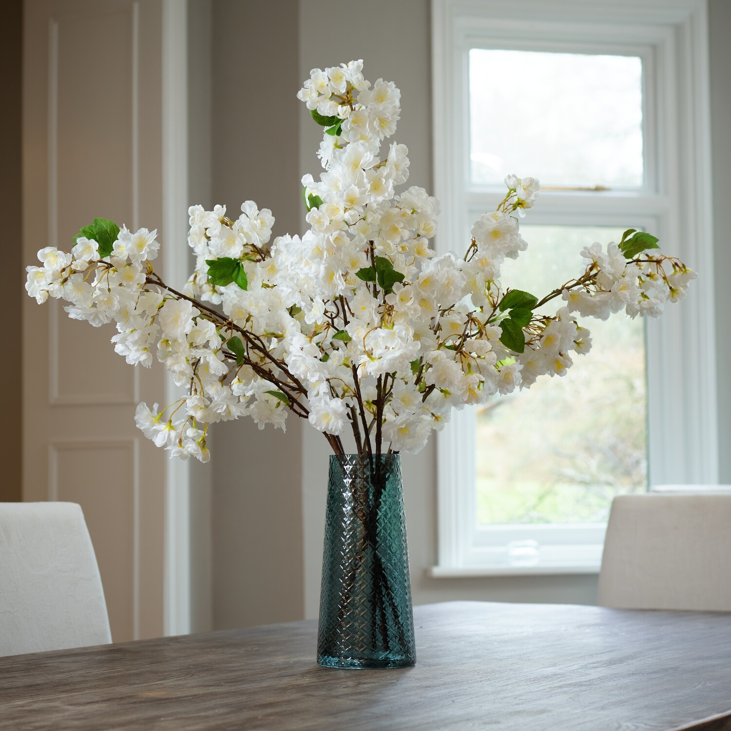 Blossom in a Blue-Smoked Textured Vase