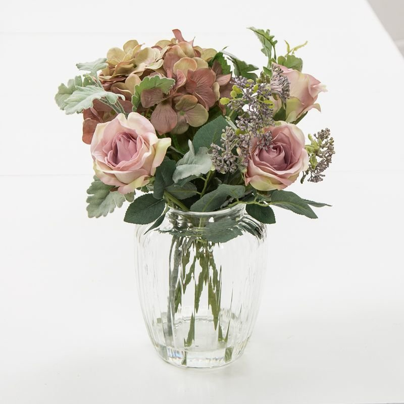 Artificial vintage mauve hydrangeas, roses, pale green foliage and summer blue patrina pick in an Optic Vase