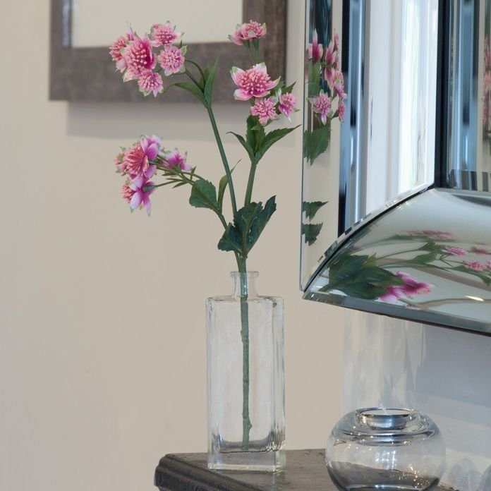 Artificial pink astranthia spray in a Genny bottle vase