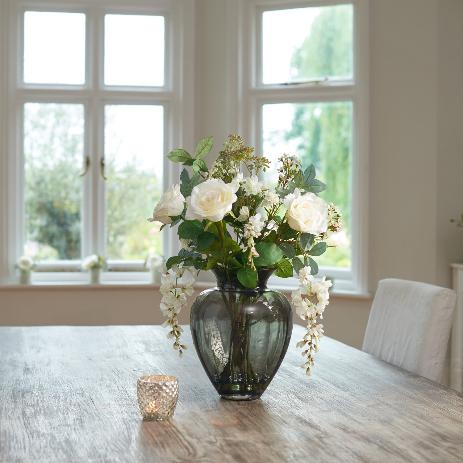 ROSES, WISTERIA AND FOLIAGE IN SMOKED OPTIC HEART VASE