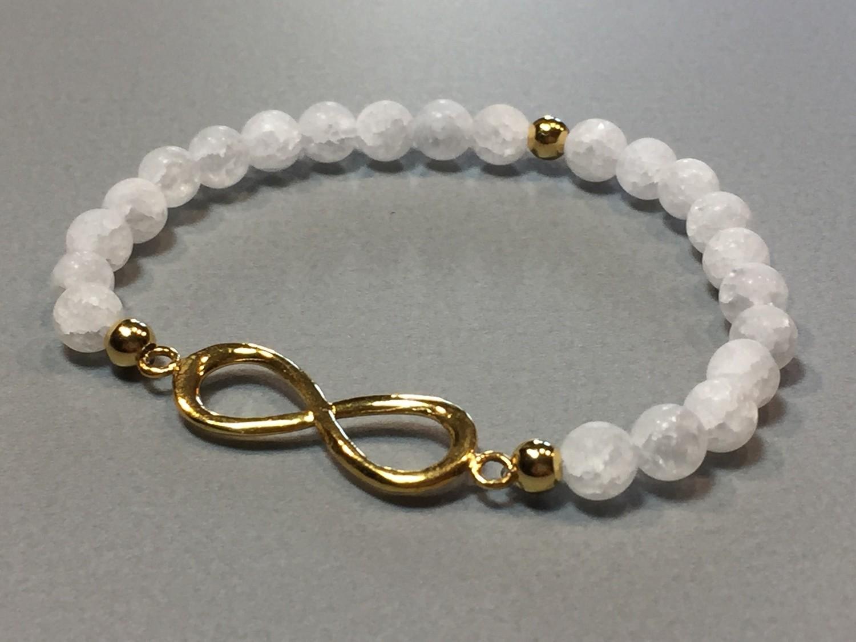 Elastisches Armband Bergkristall Infinity Silber vergoldet