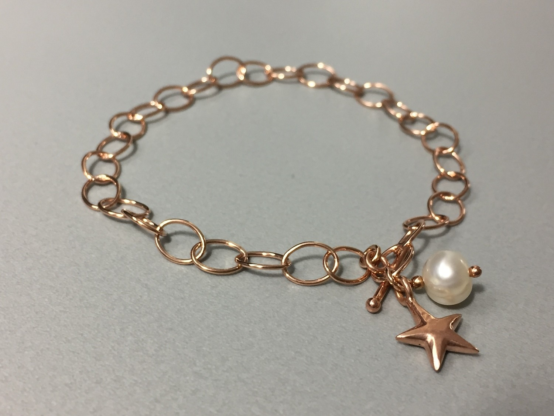 Gliederarmband mit Stern Silber rose vergoldet