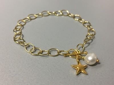 Gliederarmband mit Stern Silber vergoldet