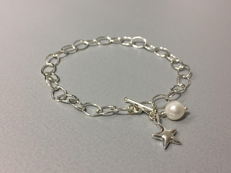 Gliederarmband mit Stern Silber