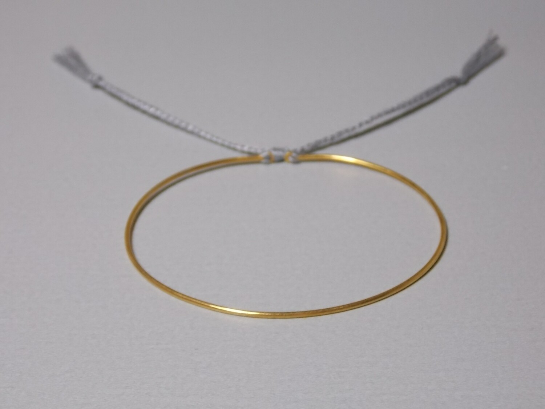 Silberarmreif vergoldet mit Baumwollband grau