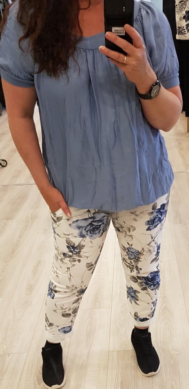 Jogging jeans blauw met grijs bloem
