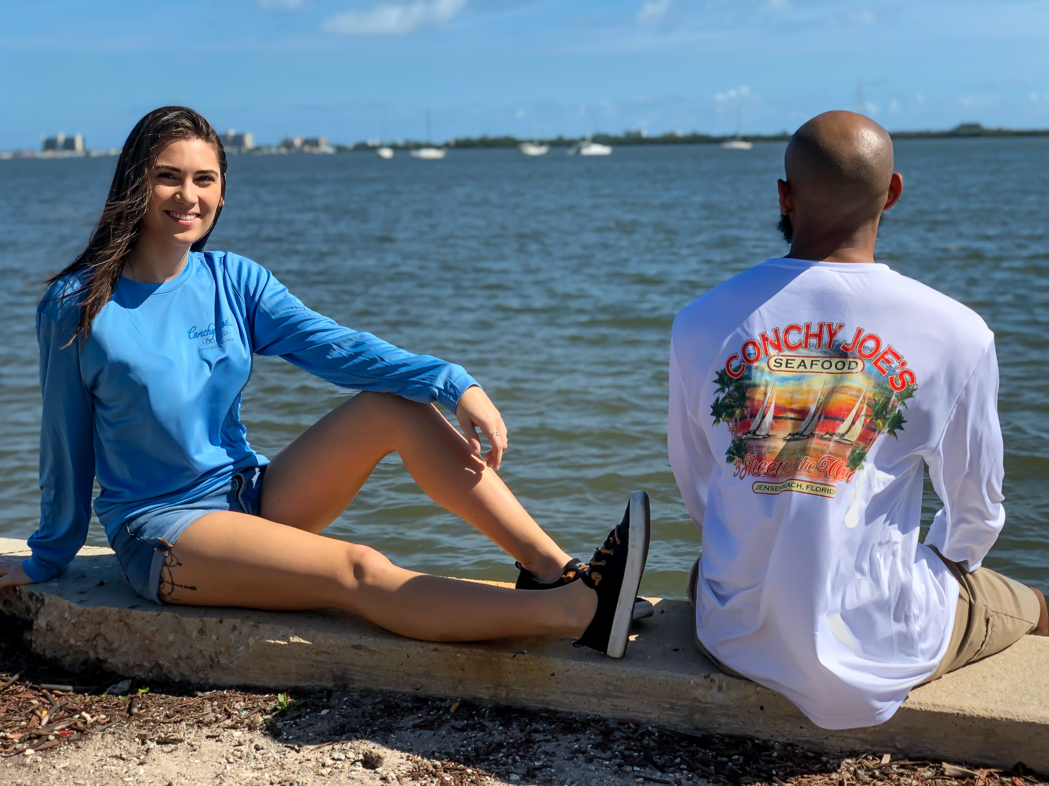 Female Model: Front of our 3 Fish Long Sleeve Male Model: Back of our 3 Sheets to the Wind Long Sleeve