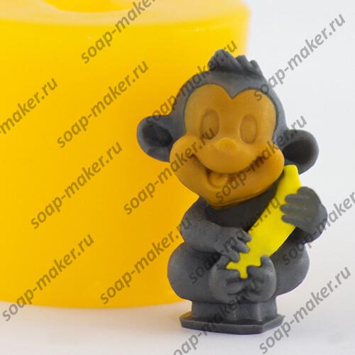 Обезьянка с бананом