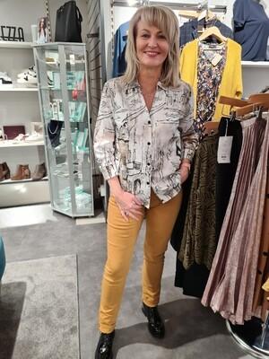 Mustard Cotton Mid Rise Slim Jean