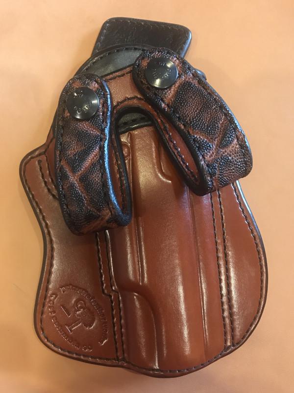 "5"" 1911 UCP chestnut body, black cowhide trim, chestnut elephant loops, pigskin lining"