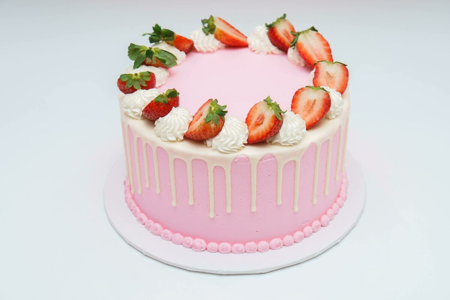Sliced Strawberry Topped Drip Cake