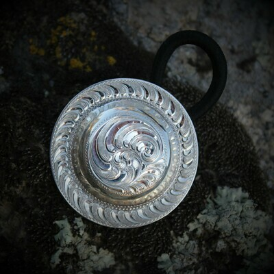 Engraved sterling silver hair concho
