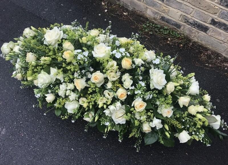 Pastel coffin spray