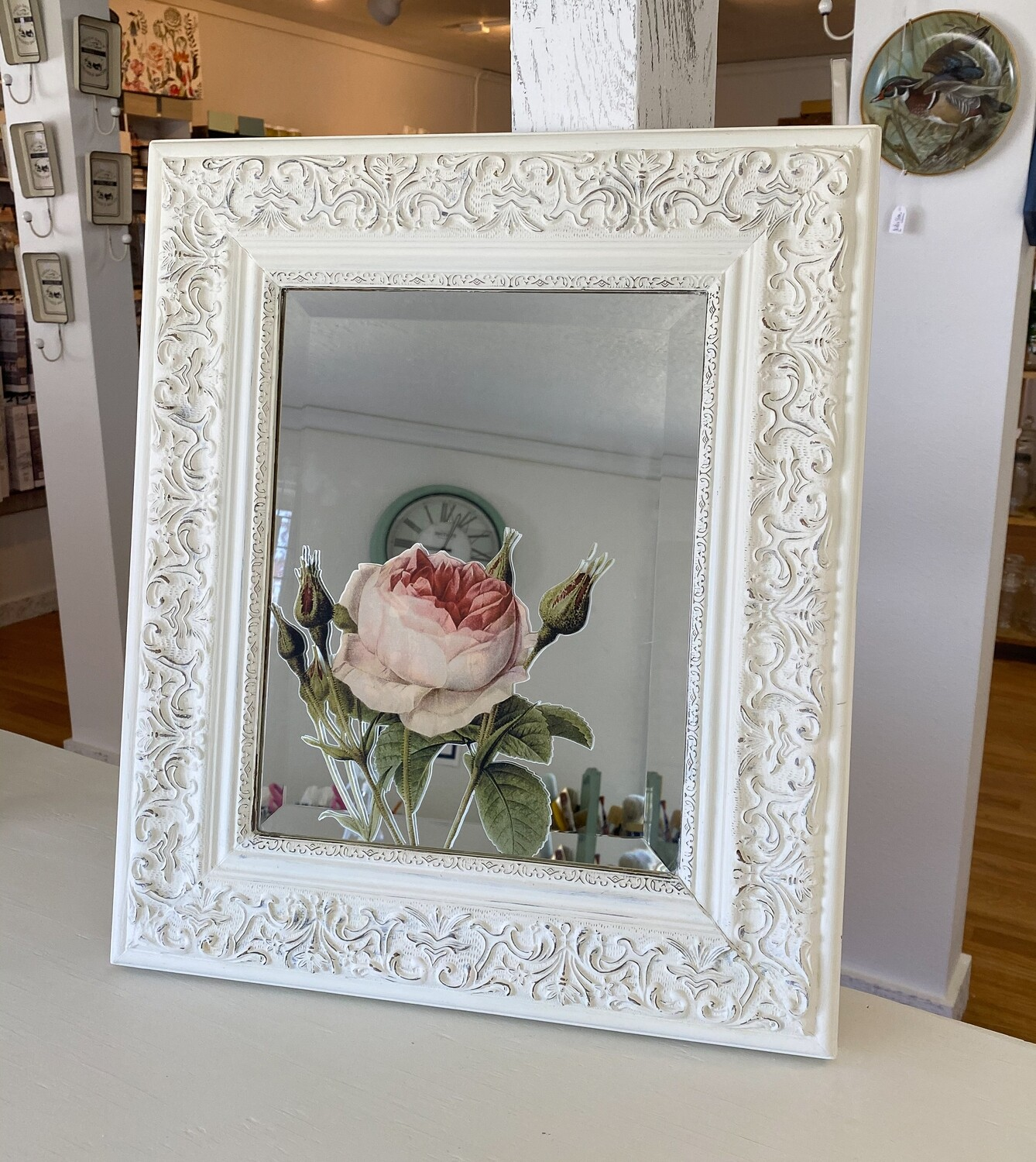 White Distressed Mirror with Floral Accent