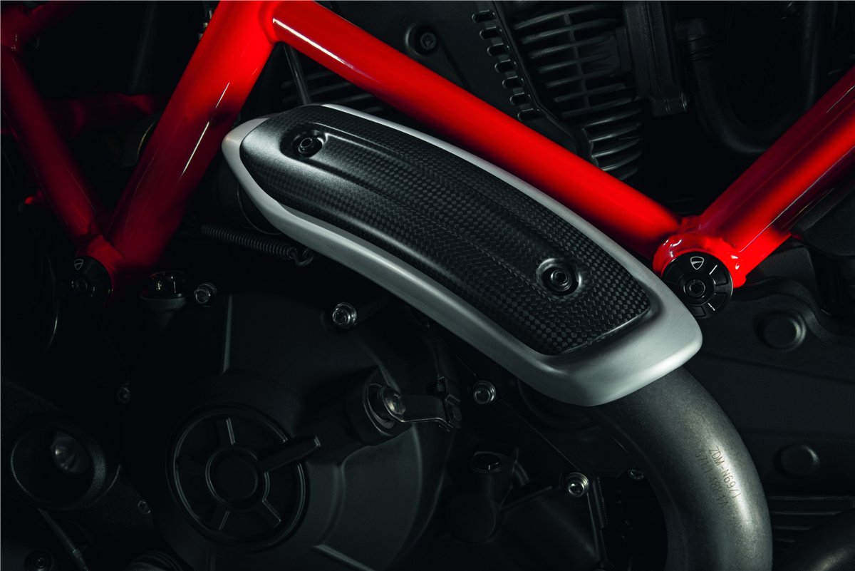 Carbon heat guard for standard and racing manifolds.