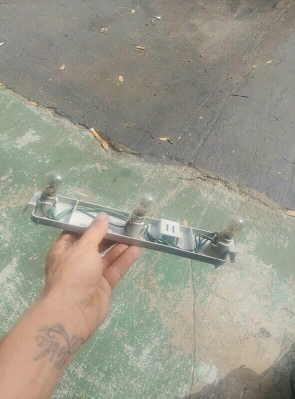 oem r32 passenger tail light bulb holder (used)