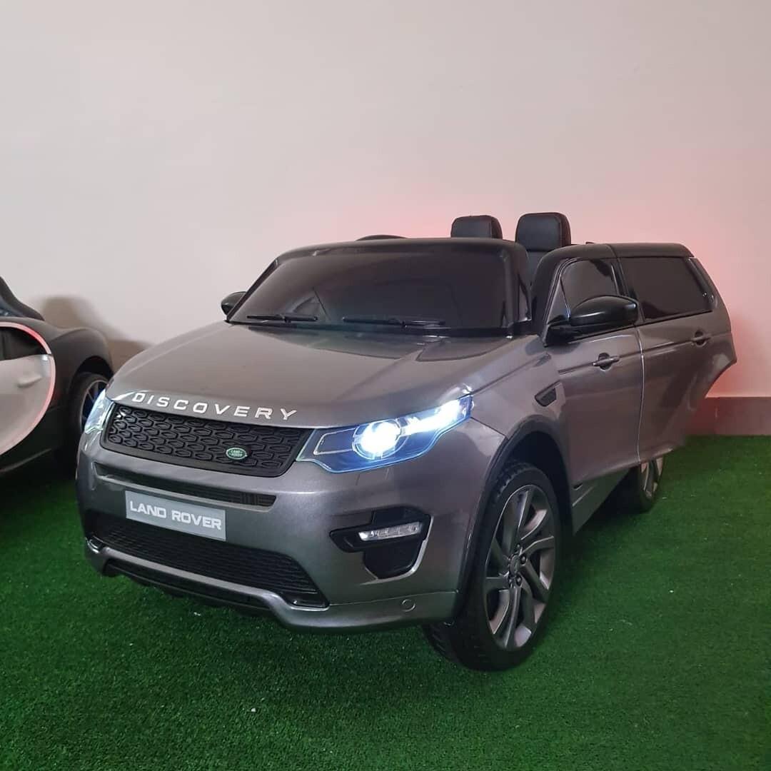 (ESCLUSIVA MANGIAFUOCOTOYS)  AUTO MACCHINA ELETTRICA PER BAMBINI Land Rover Discovery Sport 12v 2 POSTI CON TV TOUCH SCREEN e VERNICE METALLIZZATA PRODOTTO UFFICIALE (FULL OPTIONAL)