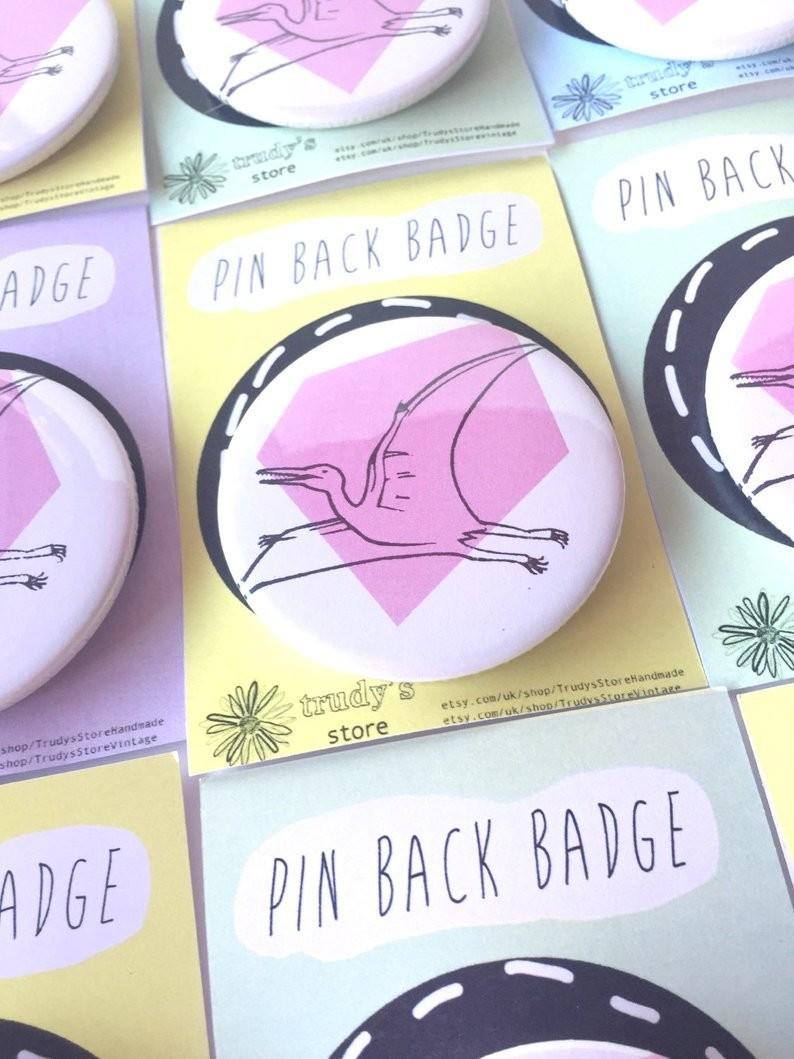 Pink Pterodactyl badge