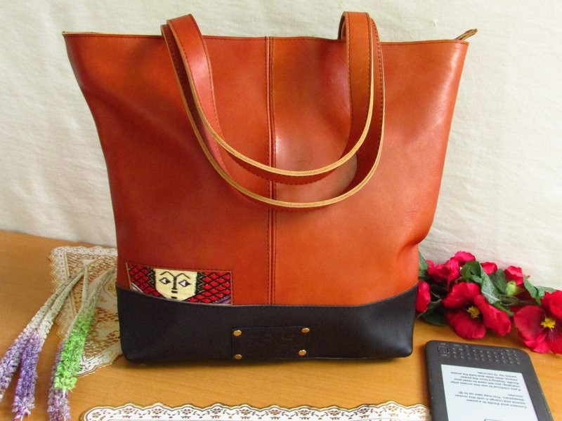Brown leather tote ethio face