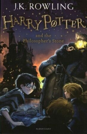 Harry Potter and the Philosopher's Stone [by] በ J.K. Rowling