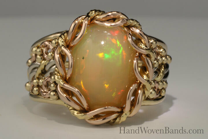 Tri-Gold Cabochon Opal Ring with Swirls surrounding the Cord of Three™ Braid