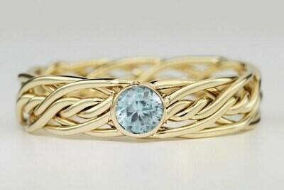 Seven Strand Ring with a Bezel Set Aquamarine