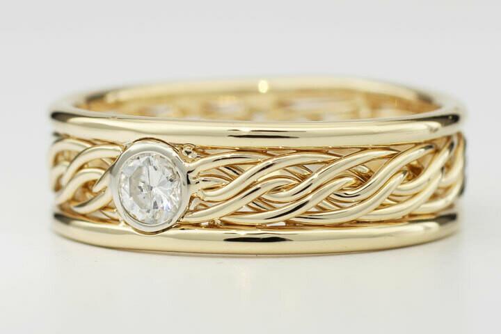 Six Strand Braided Ring with a Bezel Set Diamond