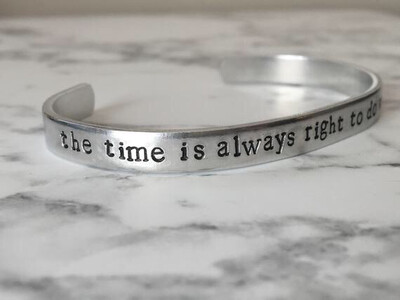 Cuff bracelet hand stamped with the words