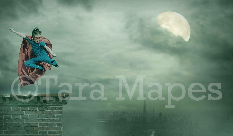 Superhero on Rooftop Over City Digital Background